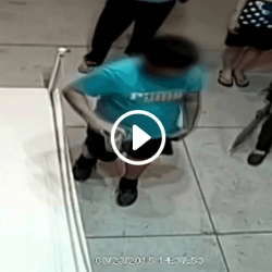 Boy punches painting