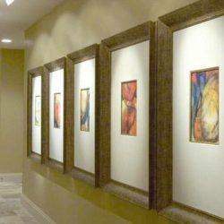 framed artwork on gallery wall