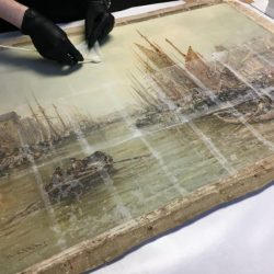 Applying Japanese tissue to consolidate cracked painting