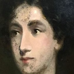 Cracked paint on portrait of woman's face