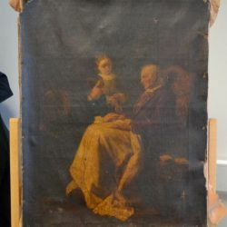 Before restoration of oil painting on a pillowacase