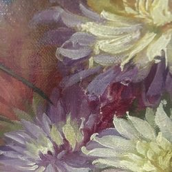 Close up of small tear in floral oil painting