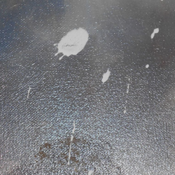 Close up of accidentally splashed paint in need of restoration