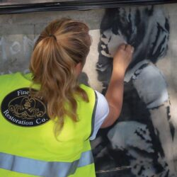 Martha restoring Extinction Rebellion Banksy at Marble Arch, London