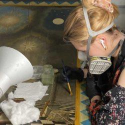 Aleksandra cleaning masonic tracing board