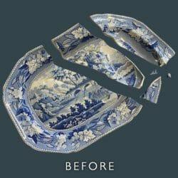 Blue and white platter before restoration